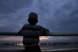 A Kashmiri child looks out over Dal Lake in Srinagar [Showkat Shafi]