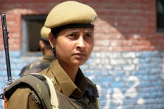 A female Indian paramilitary soldier stands guard outside a Central Reserve Police Force (CRPF) post in Srinagar, the summer capital of Indian-administered Kashmir [Showkat Shafi]
